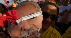 Supporters of Brazil's jailed, former President Luiz Inacio Lula da Silva rally to support him in Brasilia. Photograph: Eraldo Peres/AP Photo