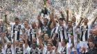 Juventus lifting  the trophy  following the last  Serie A  match of the season against Verona on May 19th, 2018,  in Turin. Photograph: Getty Images