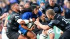 Leinster's Joe Tomane tackled by Josh Matavesi and Alex Tait of Newcastle during the  pre-season friendly at Donnybrook. Photograph:  Gary Carr/Inpho