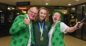 Ellen Keane of Ireland with her parents Eddie and Laura after winning bronze in the final of the Women's 200m Individual Medley SM9 event during day five of the World Para Swimming Allianz European Championships at the Sport Ireland National Aquatic Centre in Blanchardstown, Dublin. Photograph: David Fitzgerald/Sportsfile