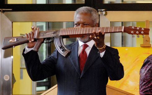 September 11th, 2007: Former United Nations Secretary General Kofi Annan displays a AK47 gun transformed to a guitar at Vienna's UN headquarters. Photograph: Herwig Prammer/Reuters