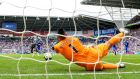 Neil Etheridge of Cardiff City dives to save Kenedy's late penalty and earn his side a point against Newcastle. Photograph: Dan Mullan/Getty