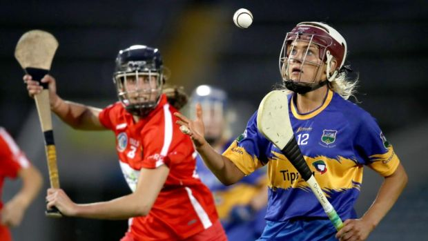 Orla O & # 39; Dwyer of Orla Cotter of Tipperary and Cork in action during the semi-finals of the Liberty Insurance All-Ireland Senior Camogie Championship at Semple Stadium in Thurles. Photo: Bryan Keane / Inpho