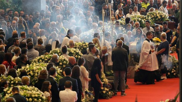 A funeral service for victims of the collapsed highway bridge, in Genoa's exhibition centre. Photograph: AP