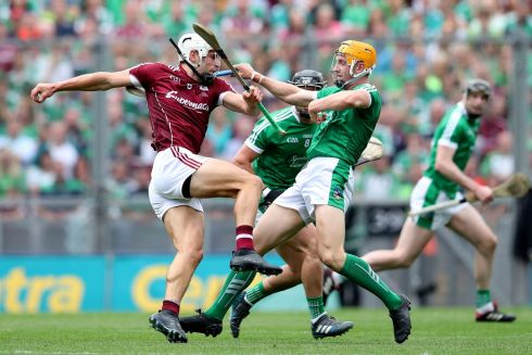Galway's Gearóid McInerney and Séamus Flanagan of Limerick in action. Photograph: Ryan Byrne/Inpho