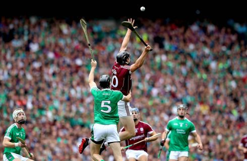 Galway's Joseph Cooney and Diarmaid Byrnes of Limerick take to the air. Photograph: Ryan Byrne/Inpho