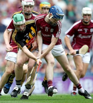 Kilkenny's Jamie Young and Niall Collins of Galway in action during the All-Ireland minor final. Photograph: Bryan Keane/Inpho