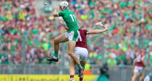Limerick's Kyle Hayes collides in the air with Galway's Joe Canning during the All-Ireland SHC Final at Croke Park. Photograph: Tommy Dickson/Inpho