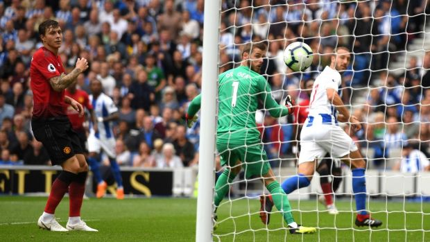 Glenn Murray opens the scoring for Brighton against Manchester United. Photograph: Mike Hewitt/Getty