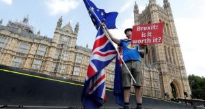 A man holds an anti-Brexit banner on Westminster Bridge in London. File photograph: Yves Herman/Reuters