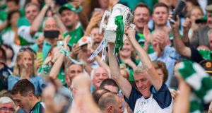 Limerick manager John Kiely lifts the Liam MacCarthy Cup. Photograph: Tommy Dickson/Inpho