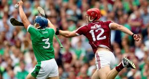 Mike Casey gets to the ball ahead of Galway's Johnny Glynn during Limerick's All-Ireland SHC final win in Croke Park. Photograph: James Crombie/Inpho