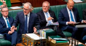 Australia's prime minister Malcolm Turnbull (second left) answers a question from the opposition in parliament as minister for home affairs Peter Dutton (right) listens  in Canberra on Monday. Photograph: Sean Davey/AFP/Getty Images