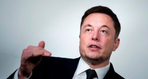Elon Musk, chief executive of Tesla. Right now the world's attention has shifted away from his plans to get to Mars and back to Tesla.  Photograph: Brendan Smialowski/AFP/Getty Images