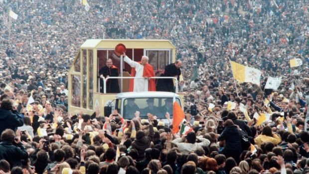 The pope in Ireland: John Paul II waves to crowds in 1979. Photograph: Anwar Hussein/Getty