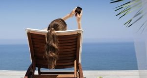 Hello to an influx of push notifications on the beach. Photograph: iStock