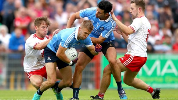 Tyrone's Mark Bradley and Niall Sludden tangle with Jonny Cooper and Cian O'Sullivan of Dublin during the Super 8s clash in Omagh. Photograph: James Crombie/Inpho