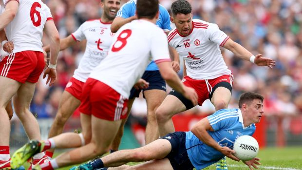 Tyrone players close in on Dublin's Brian Howard. Their message could be: 'we aren't allowing you to draw us out. But see when you do attack, we will be here, we will be waiting, we will turn you over'. Photograph: James Crombie/Inpho
