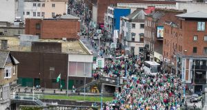 The Limerick hurling team make their way on an open top bus over Sarsfield Bridge and the river Shannon on route to the homecoming celebrations at the Gaelic Grounds on Monday evening. Photograph by Eamon Ward