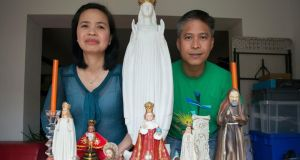 Lorna and Marlou Patindol, from the Philippines: hope the papal visit can draw people back into the Catholic Church.   Photograph: Dave Meehan