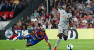 Liverpool's Sadio Mane on his way to scoring his team's second goal. Photograph: Reuters