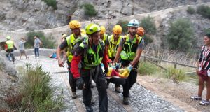Rescue personnel carries a stretcher with a hiker who was recovered from the Gorge of Raganello where the flood of a torrent caused several victims, in Civita, southern Italy, August 20th, 2018. Photograph: EPA/ANTONIO IANNICELLI