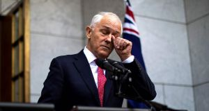 Australia's prime minister Malcolm Turnbull  takes part in a press conference in Canberra on Tuesday. Photograph: Sean Davey/AFP/Getty Images