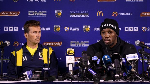 Usain Bolt with Central Coast Mariners boss Mike Mulvey. Photograph: Dan Himbrechts/EPA