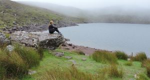 Rachel Flaherty at Lake Muskry in the Galtee Mountains, Co Tipperary. Photograph: Neil Coles