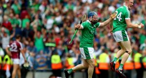 Limerick's Richie McCarthy and William O'Donoghue celebrate at the final whistle after victory over Galway at Croke Park. Photograph: James Crombie/Inpho