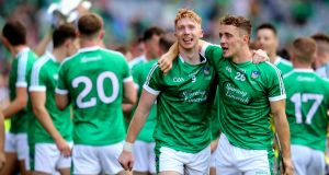 Limerick's Cian Lynch and Pat Ryan celebrate after the game. Photograph:  Ryan Byrne/Inpho