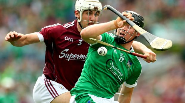 Galway's Daithi Burke and Peter Casey of Limerick. Photograph: James Crombie/Inpho