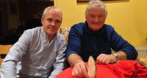 Vincent O'Brien and Noel McDonagh of Waterford History Group with a flint axe.