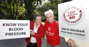 Broadcaster Marty Morrissey with Bobby Mulvaney from Sallins Men's Shed get their blood pressure checked at the Irish Heart Foundation's Mobile Health Unit.  Photograph: Sasko Lazarov/Photocall Ireland
