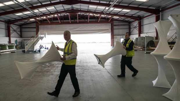 Ron Mellerick, fire security officer, and Sean Murtagh, security officer at Ireland West Airport Knock, moving tables in preparation for the visit of Pope Francis. Photograph: Keith Heneghan