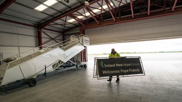 Donal Healy, marketing manager at Ireland West Airport Knock, carrying signs in preparation for the visit of Pope Francis. Photograph: Keith Heneghan