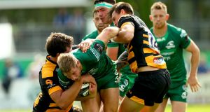 Connacht's Kyle Godwin is tackled by Charlie Matthers and Ambrose Curtis of Wasps in a pre-season friendly at Dubarry Park, Athlone last Saturday. Photograph: James Crombie/Inpho