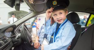 Fionn Doyle (7) pictured in a Garda car in Kildorrery, north Cork. His mother Eimear put out an appeal for people to send him a card for his birthday - and thousands of people from all over the world responded. Photograph: Daragh Mc Sweeney/Provision