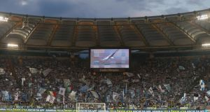 Lazio fans at the Stadio Olimpico during a fixture against Internazionale. Photograph: Paulo Bruno/Getty