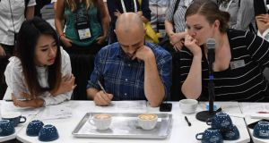 But is it art? Judges at work at the Latte Art World Championship Open in Los Angeles, California. Photograph: Mark Ralston/AFP