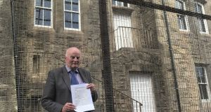 Michael McLoughlin, in front of the former police station in Dungannon, Co Tyrone,  where he went to hand in the notice applying for the march.