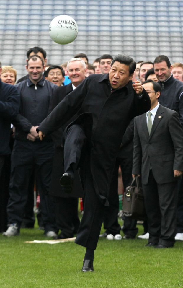 Chinese vice-president Xi Jinping kicks a Gaelic football as he visits Croke Park in Dublin in February 2012. Photograph: Peter Muhly/AFP/Getty