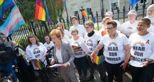 Journalist Ursula Halligan spoke before the performance of the  'Rainbow Choir', made up of LGBTI singers who gathered outside the World Meeting of Families at the RDS on Thursday, to sing in protest at the exclusion of LGBTI people and their families from the event. Photograph: Dave Meehan