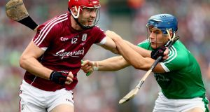 Limerick's Mike Casey keeps a close eye on Galway's Jonathan Glynn during the key match-up in the All-Ireland hurling final. Photograph: James Crombie/Inpho