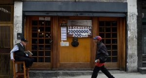 A restaurant in Caracas displays a price in bolívars and sovereign bolívars. The IMF predicted inflation in Venezuela would reach a million per cent by the end of the year. Photograph: Federico Parra/AFP/Getty Images