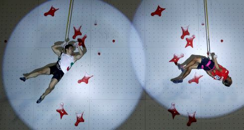 HIGH LIGHTS: Reza Alipour of Iran and Sabri Sabri of Indonesia compete in climbing at the 2018 Asian Games, Palembang, Indonesia. Photograph: Edgar Su/Reuters