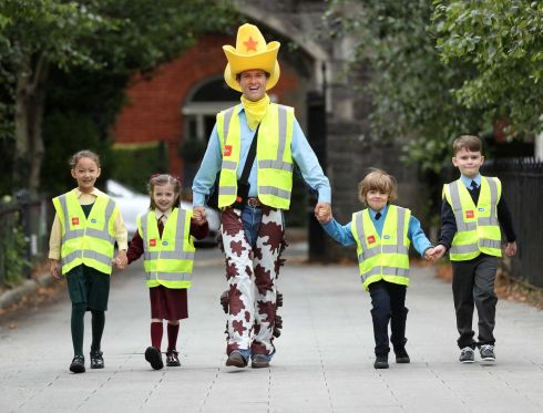 STAR PUPILS: The RSA Seatbelt Sheriff is pictured with returning schoolchildren at St Brigid's Primary School, Haddington Road, Dublin. Photograph: Robbie Reynolds