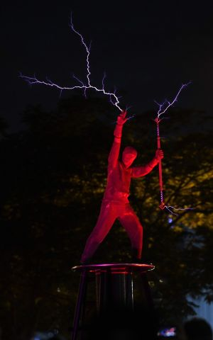 STRIKE A POSE: Artists perform in 'The Duel' by Lords of Lightning during the Singapore Night Festival in Singapore. Photograph: Roslan Rahman/AFP/Getty Images