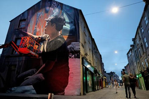 UP THE WALLS: Artist 'Mantra' puts the finishing touches on his piece for the Waterford Walls international street art festival. Photograph: Julien Behal Photography
