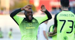 Celtic's Olivier Ntcham celebrates scoring their first goal with Michael Johnston during the  Europa League  playoff first leg  against  FK Suduva at Suduva Stadium in  Marijampole, Lithuania. Photograph: Ints Kalnins/Reuters